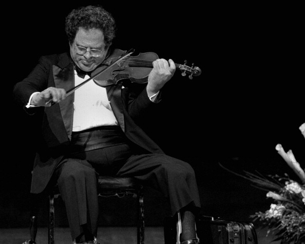 11/13/95: Itzhak Perlman, concert violinist plays his own musical tribute at the memorial service to